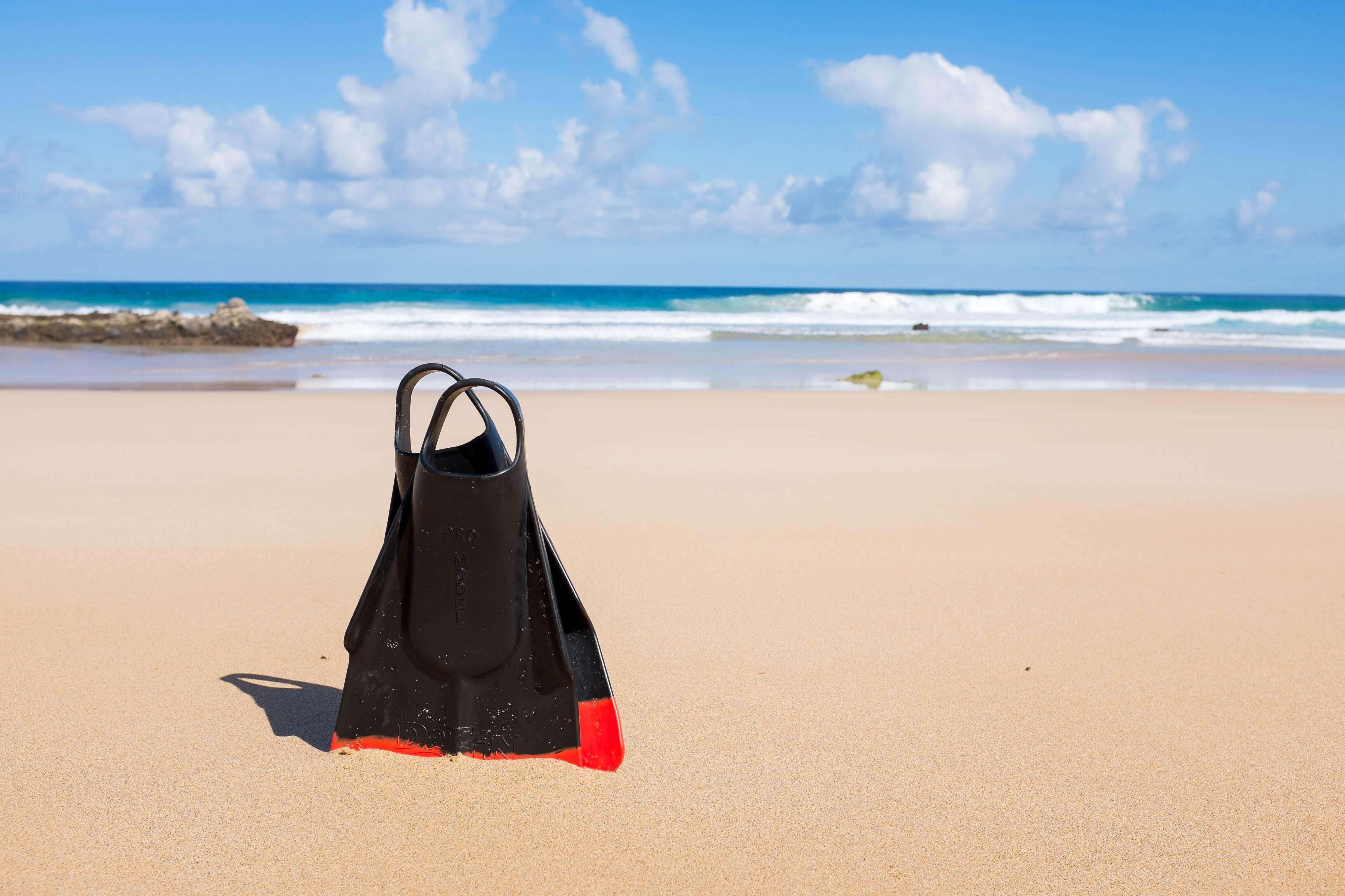 scuba fins on a beach