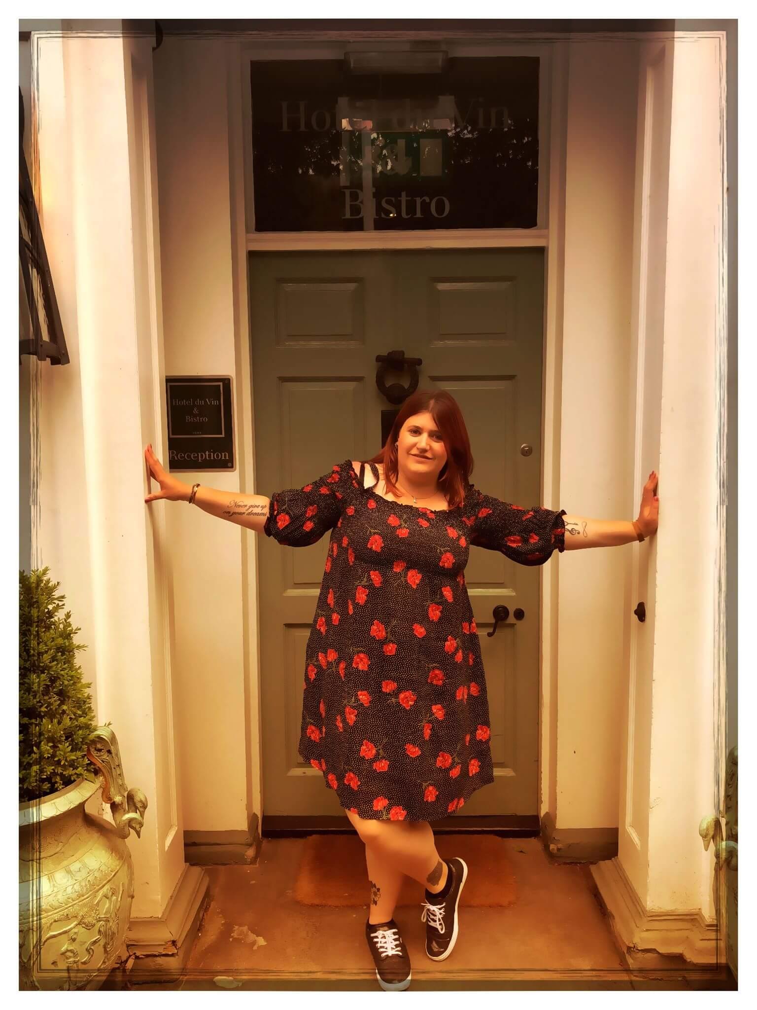 me in the doorway of hotel du vin wearing a river island bardot dress